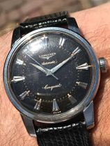 Longines Conquest reference 9000 black brown gilt dial
