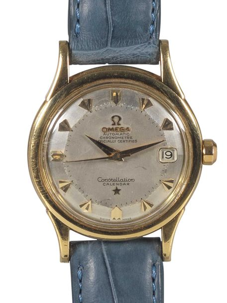 Omega Omega Constellation Calendar date 1957 with a solid gold case and pie pan dial